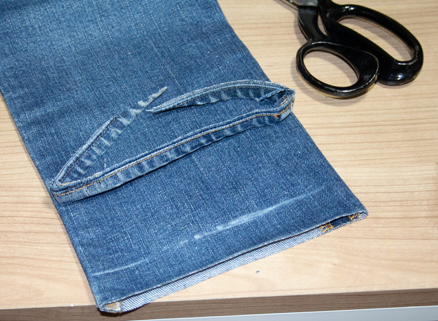 Original hem cut off the leg bottom to repair with traditional hemming