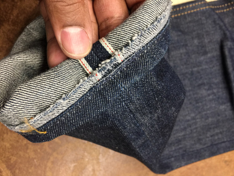 Inside view shows what is original hem or how it is sewn