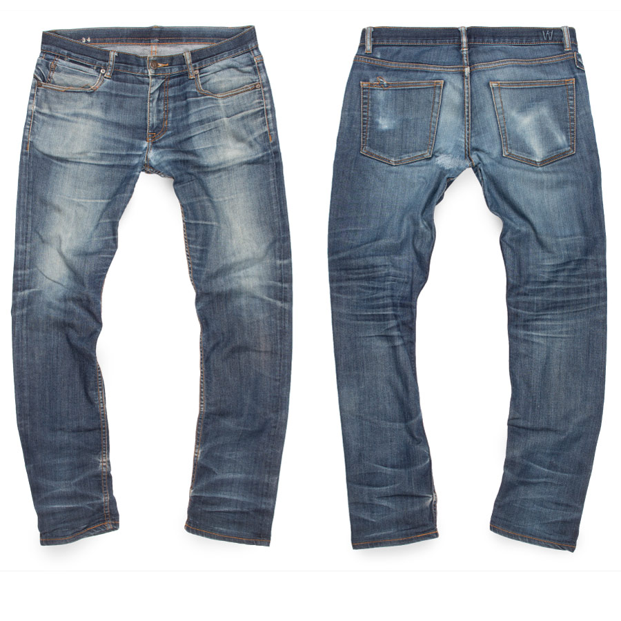 Light distressed jeans aged from raw denim