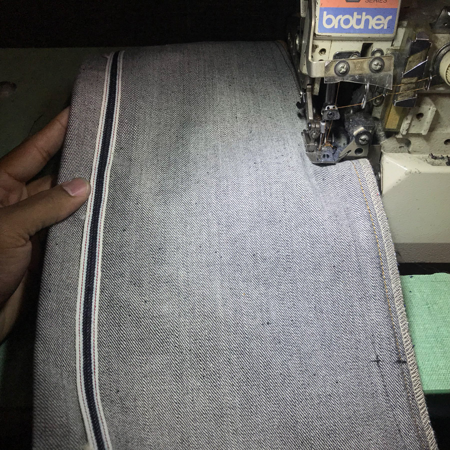 Inseam of jeans in the process of sewing with overlock serger